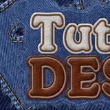 miniature Texte cuir cousu sur du jean